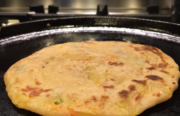 Stuffed parata with boiled potatoes and carrots